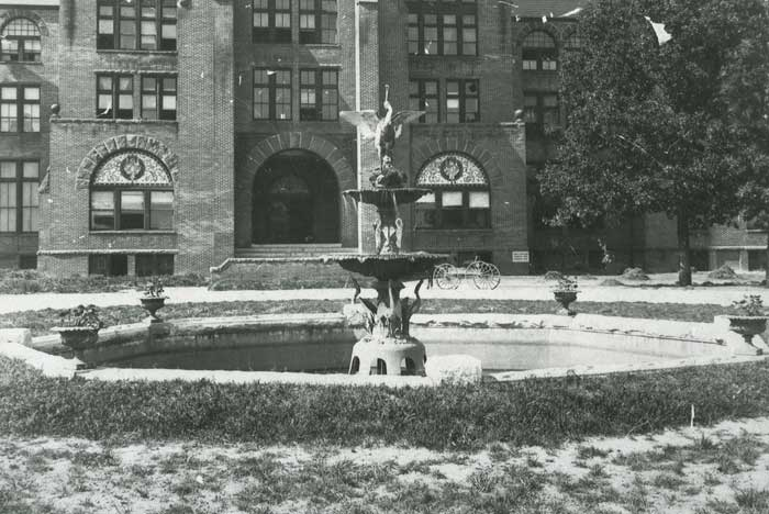 The Anne Roney Fountain, with the Washington Duke Building in the background. Photo undated, but between 1897-1911.
