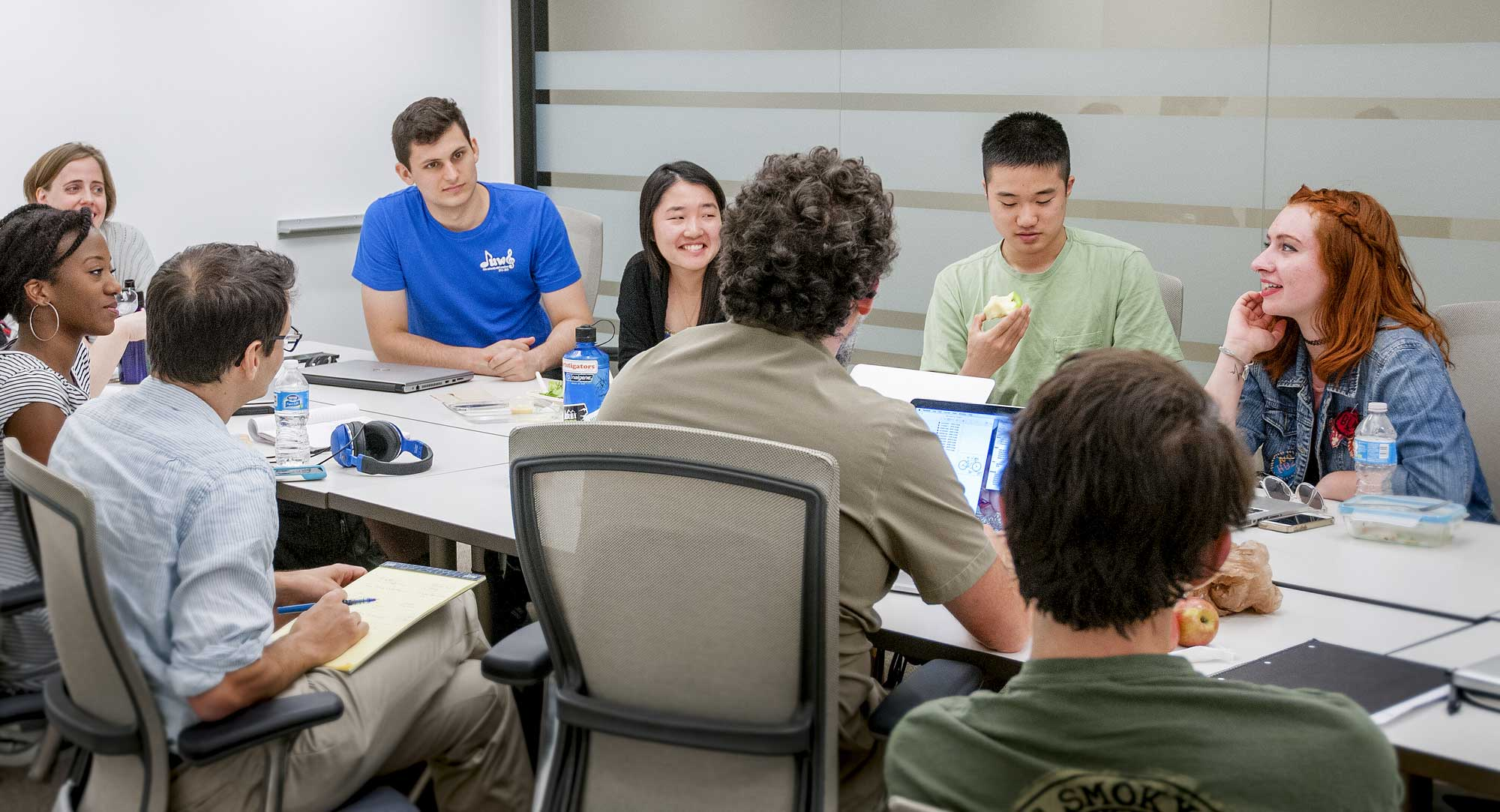 Students and faculty discuss research strategies during a Duke History Revisited meeting.