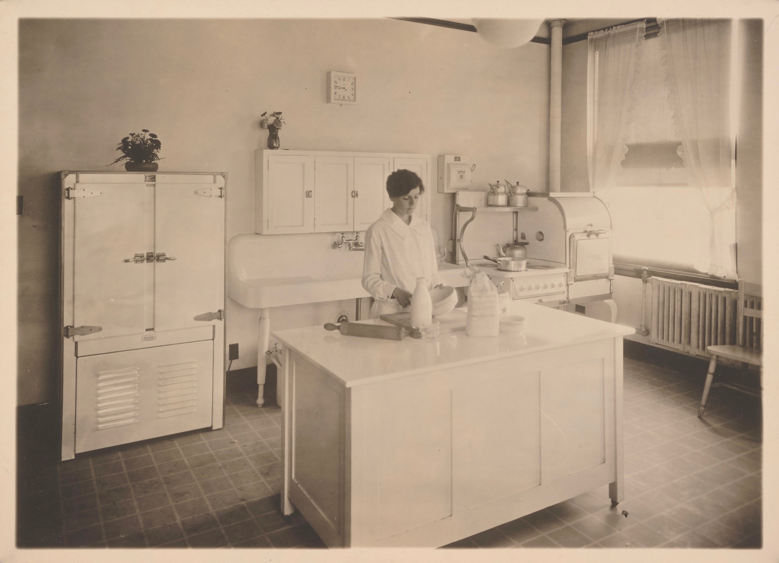 Woman in JWT test kitchen, mixing a batter.