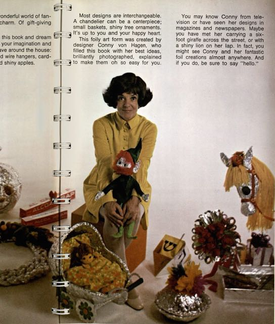 "Photograph of page from ""401 Party and Holiday Ideas"" showing the author Connie Van Hagen  showing off the aluminum foil crafts she has created"