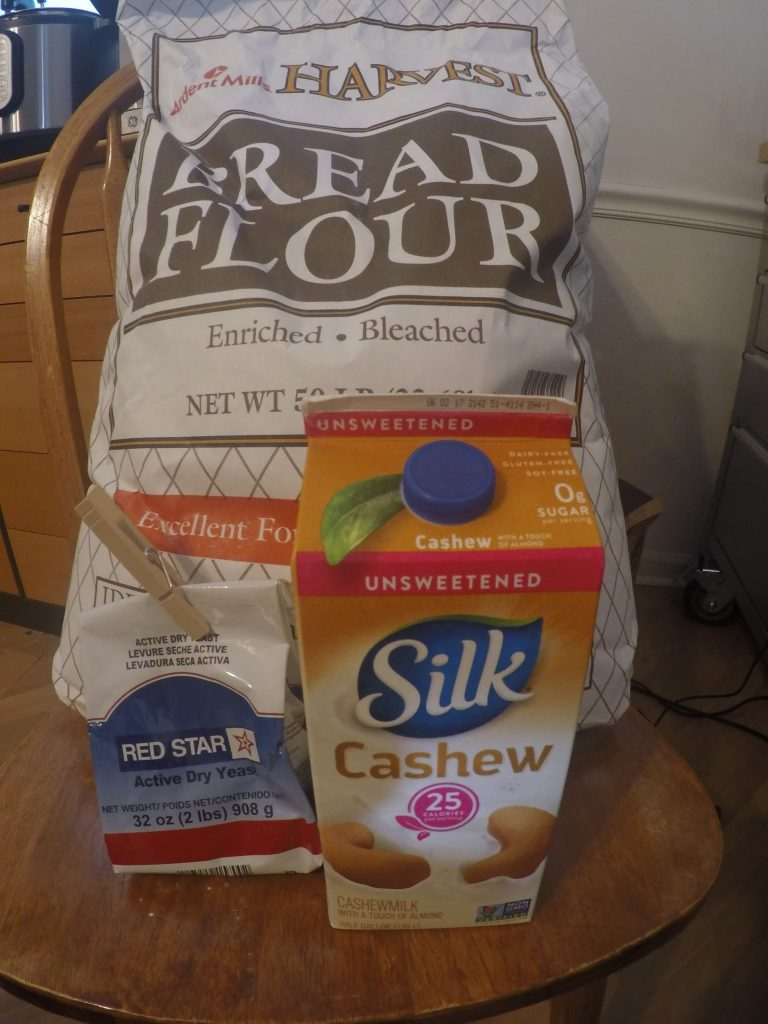 Photograph of ingredients used in the recipe: bread flour, active dry yeast, and cashew milk