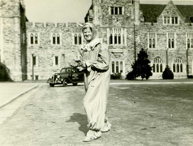 The Duke Blue Devil in a clown-like costume, ca. 1930s