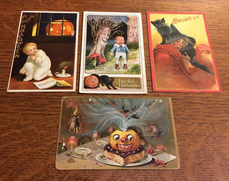 Photo of four Halloween postcards