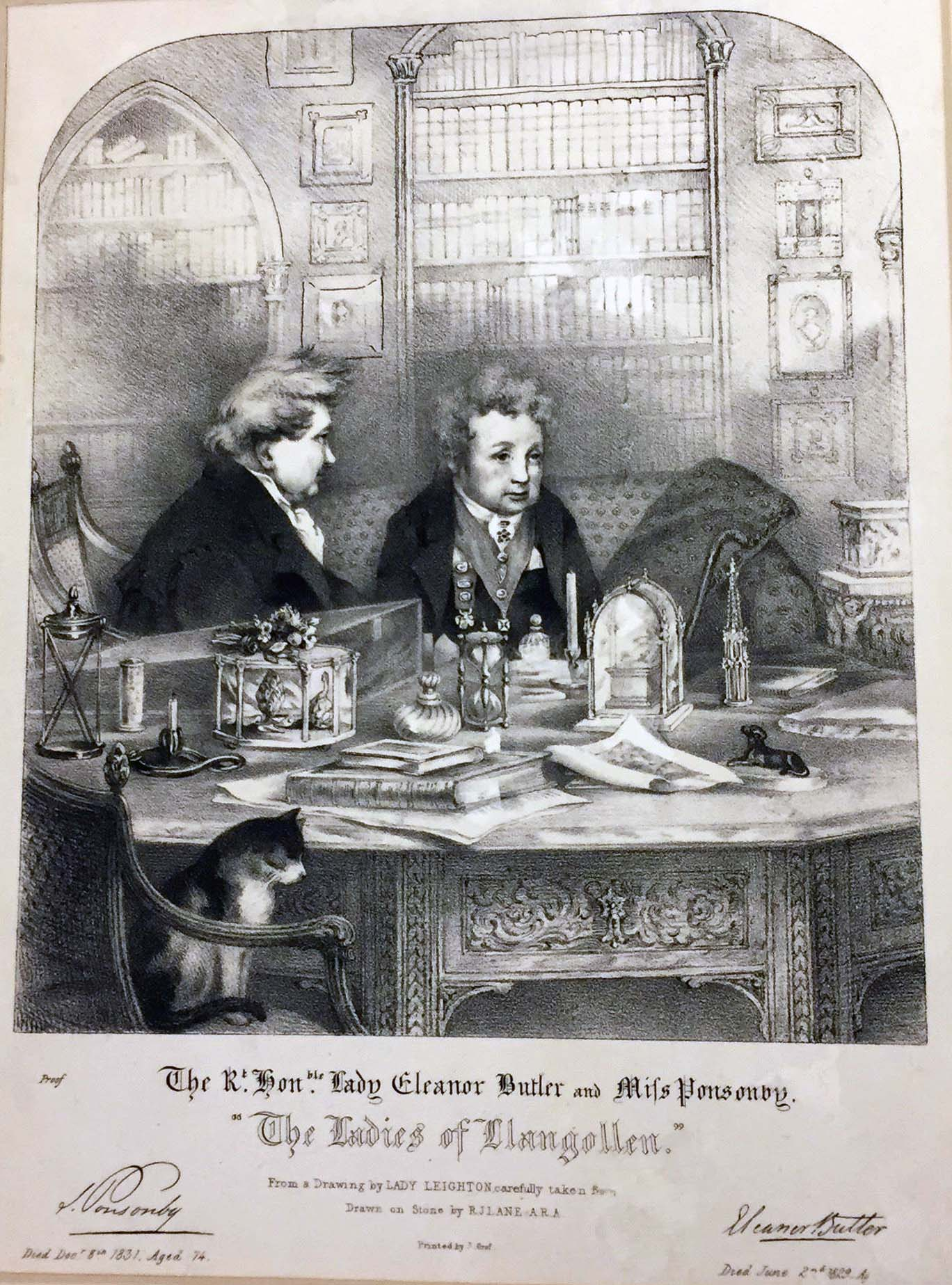 Eleanor Butler and Sarah Ponsonby sitting at table with books and cat