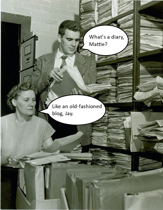 "Black and white photograph of two people in a room filled with shelves of files. The man, standing, is hold open a file filled with peppers, he has a cartoon speech bubble and asks ""What's a Diary, Mattie?"". The woman, seated also has a cartoon speech bubble which reads ""Like an old-fashioned blog, Jay."""