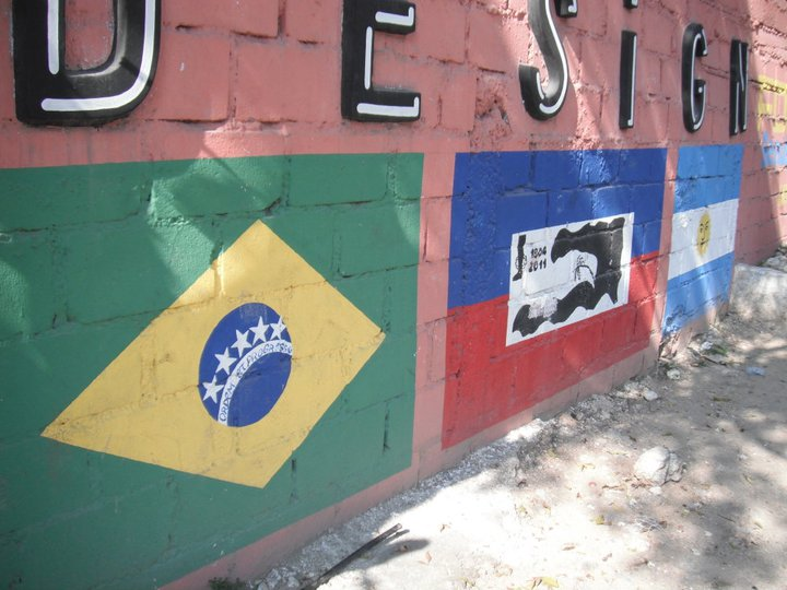 Flags painted on a brick wall.