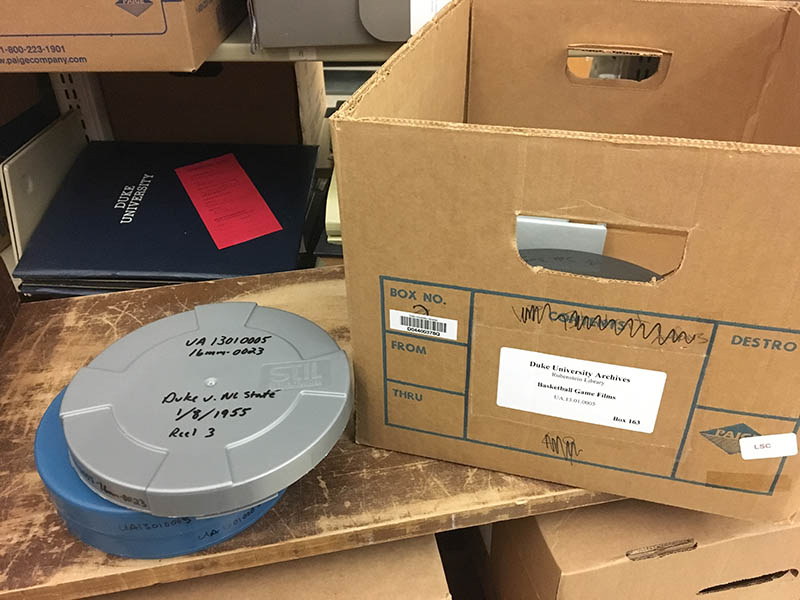 Color photo of a Paige box and two film cans from our Game Films collections.