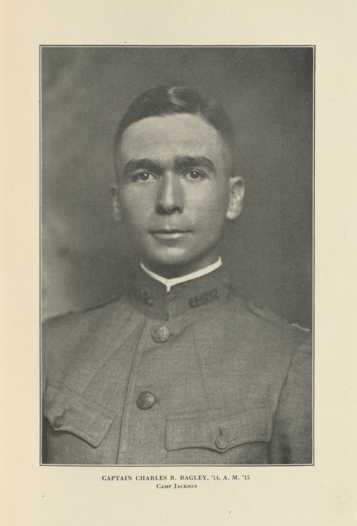 scan of a page of a book. the only thing on the page is a black and white photograph of a young white man in a military uniform. His hair is cut short, he doesn't have any facial hair, and he is looking directly at the camera.