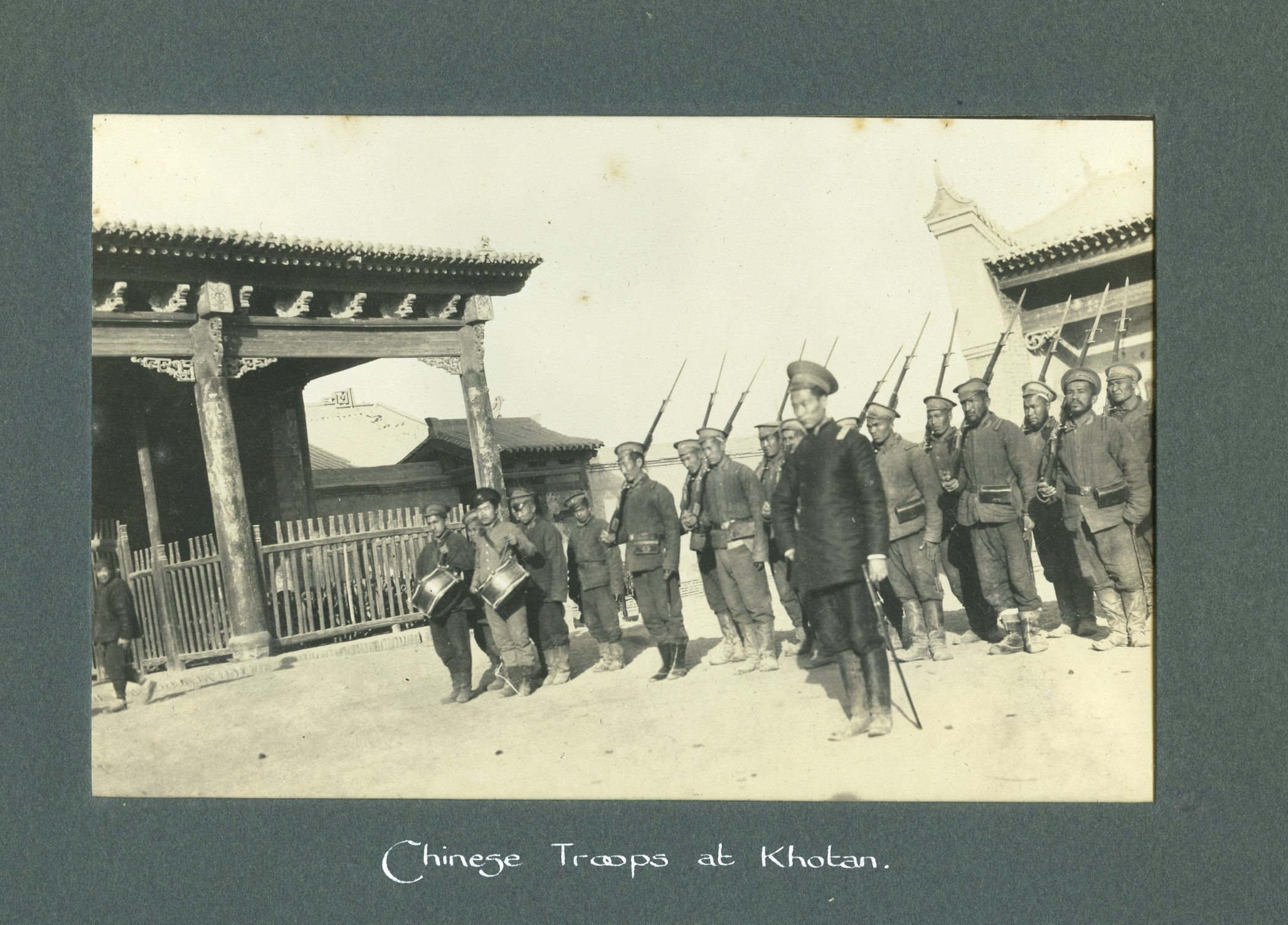 Chinese troops lined up with bayonets and drummer boys.