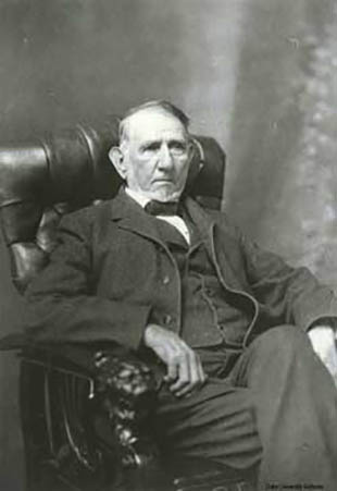 Portrait photograph of Washington Duke sitting in an armchair.