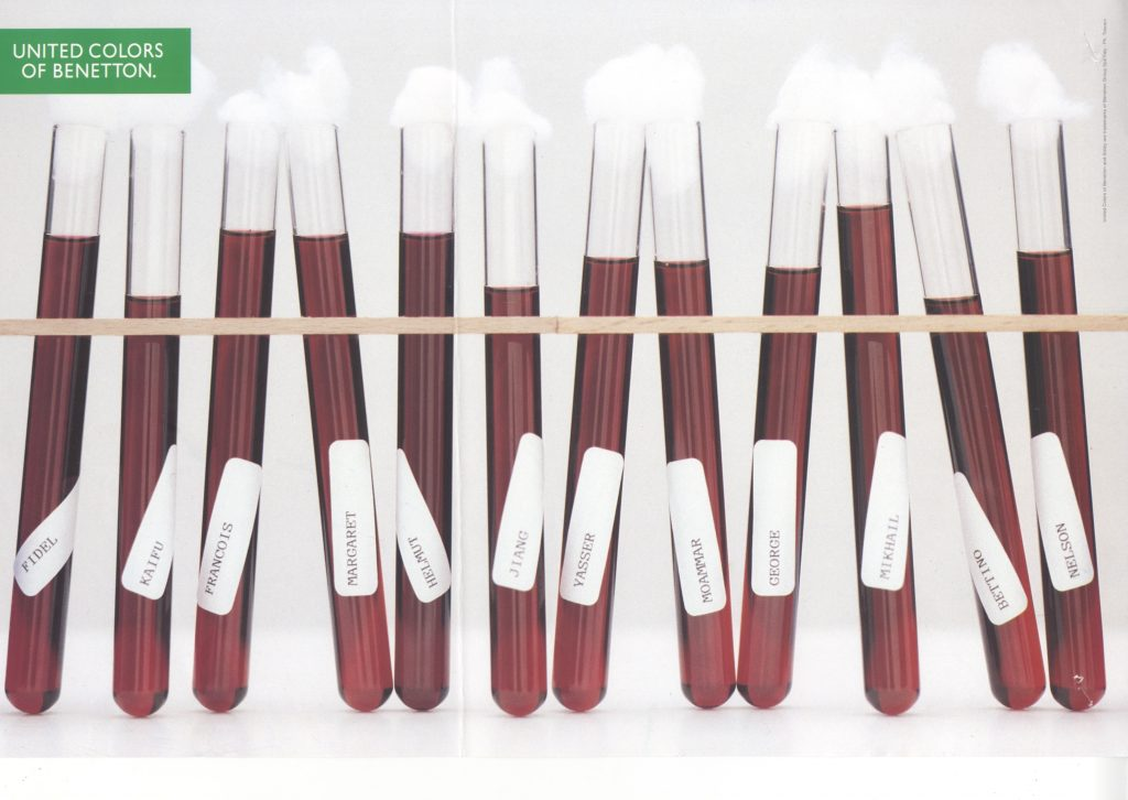 Color Benetton advertisement, showing vials of blood. The vials are each labeled with a different. The names are ethnically diverse and include Fidel, Kaifu, Helmut, Jiang, George, and Mikhail.