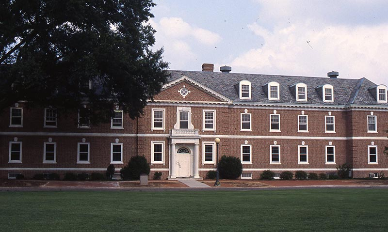 Color photo of the front of Wilson Residence Hall. The three-story brick building is Georgian in style.