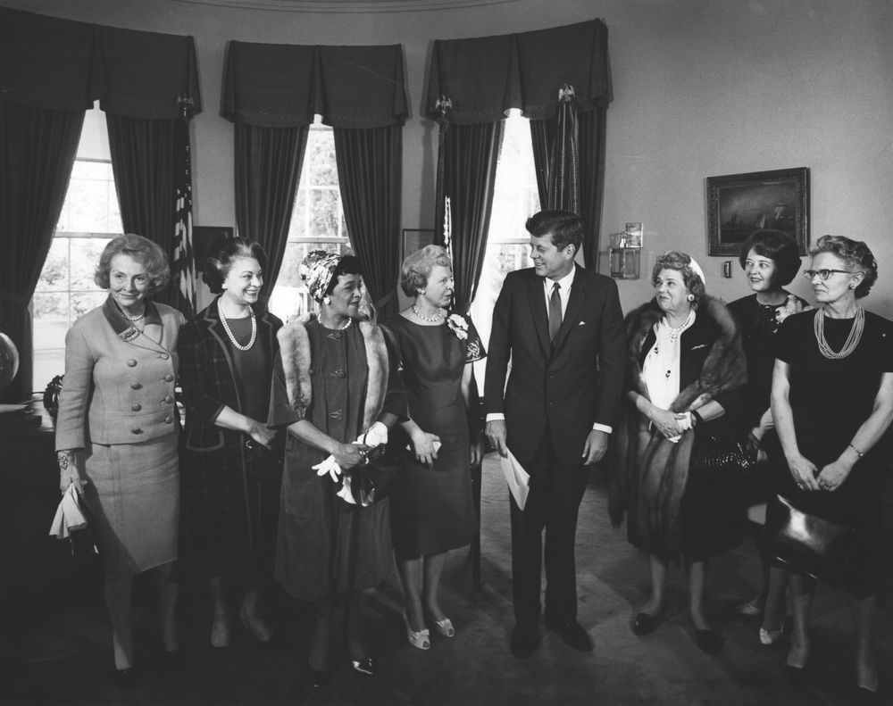 President John F. Kennedy with the recipients of the 1963 Federal Woman's Award for outstanding contributions to government. Eleanor Pressly is second from the right. Photo from the John F. Kennedy Presidential Library and Museum.