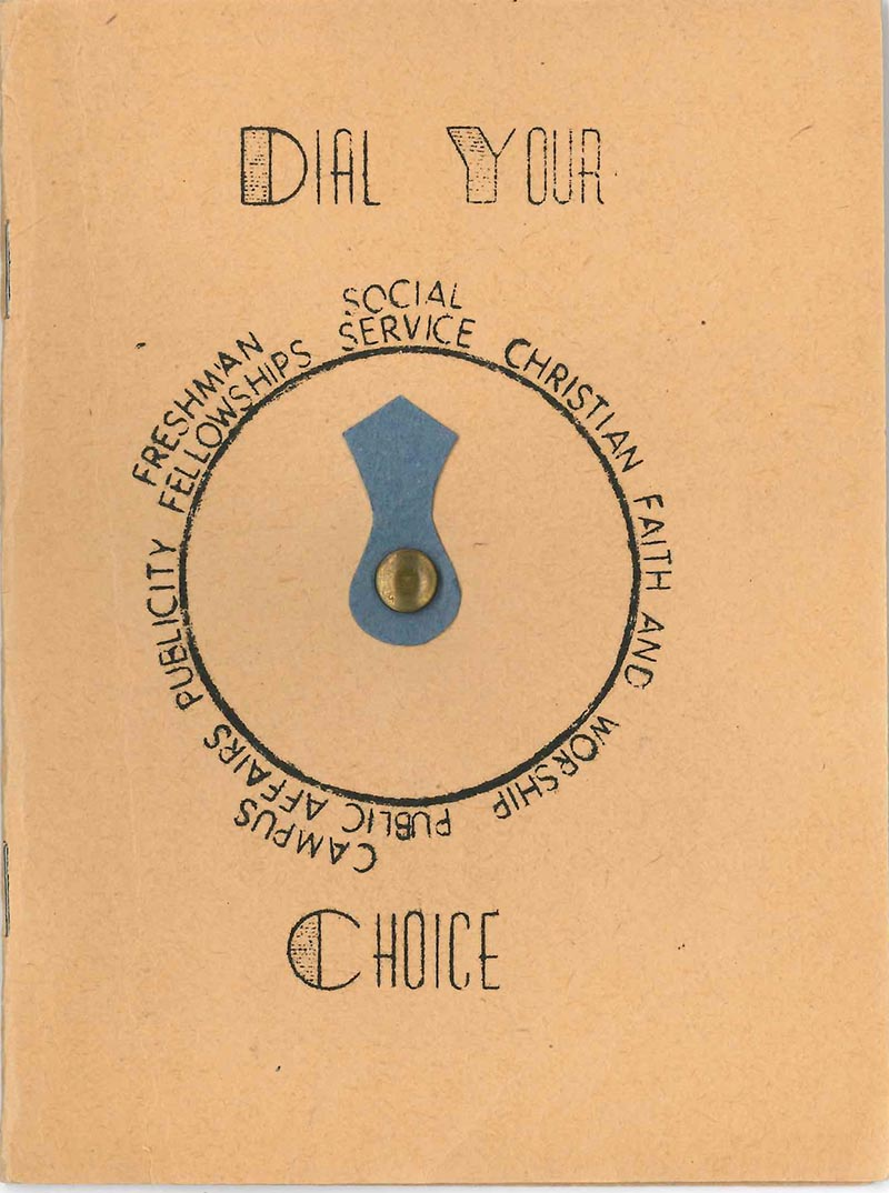"Cover of a 1930s YWCA handbook for first-year students. The cover is tan construction paper and bears the title ""Dial Your Choice."" A dial with a blue spinning pointer is in the center of the cover; the dial choices are freshman fellowships; social service; Christian faith and worship; campus public affairs; and publicity."