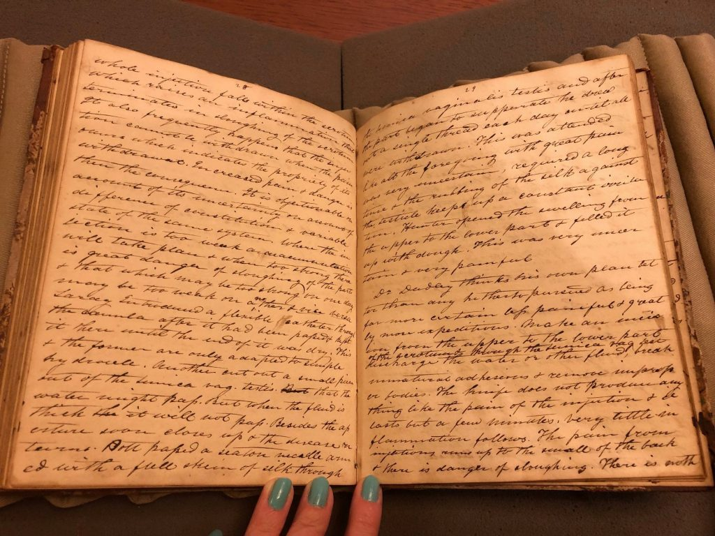 Two open pages of Davisson's notebook. Each page is filled with Davisson's handwritten cursive notes