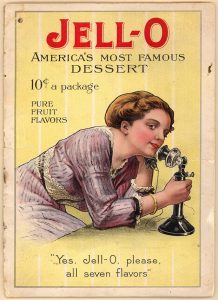 "Vintage Jell-o advertisement, showing a woman with an old-timey telephone. The text reads ""Yes, Jell-o, please, all seven-flavors."""