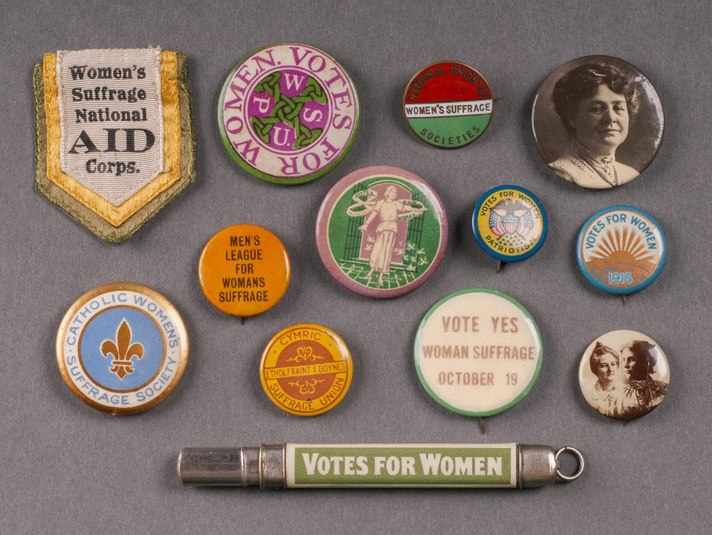 Array of buttons promoting women's suffrage