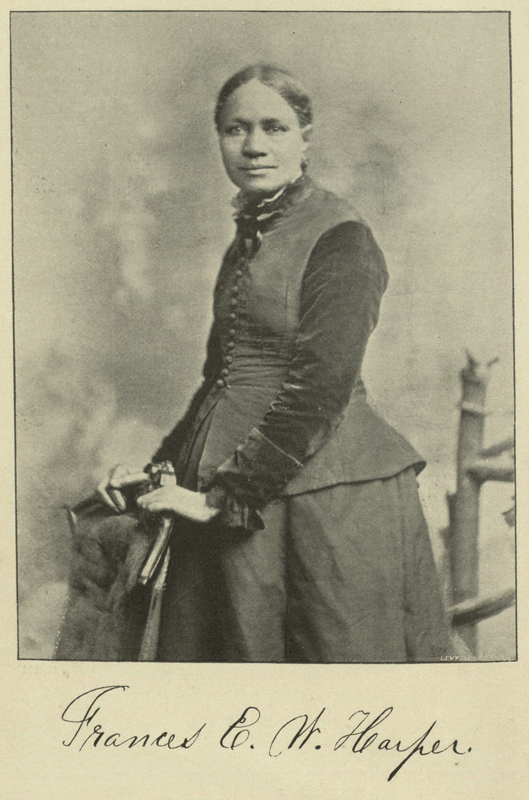 Printed photo of Frances Ellen Watkins Harper. Her head faces the camera while her body is turned to the left. A reproduction of her signature appears below the photo.