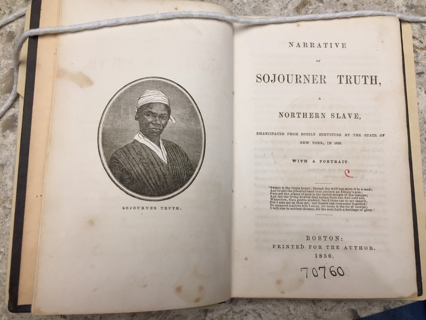The Rubenstein's copy of The Narrative of Sojourner Truth (1850), opened to the title page and frontispiece with engraving of the author.