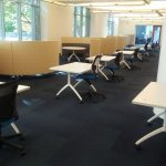 Photo of a row of tables with single chairs in the Jones Open Lab.