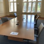 Large conference table in front of windows in Rubenstein 249